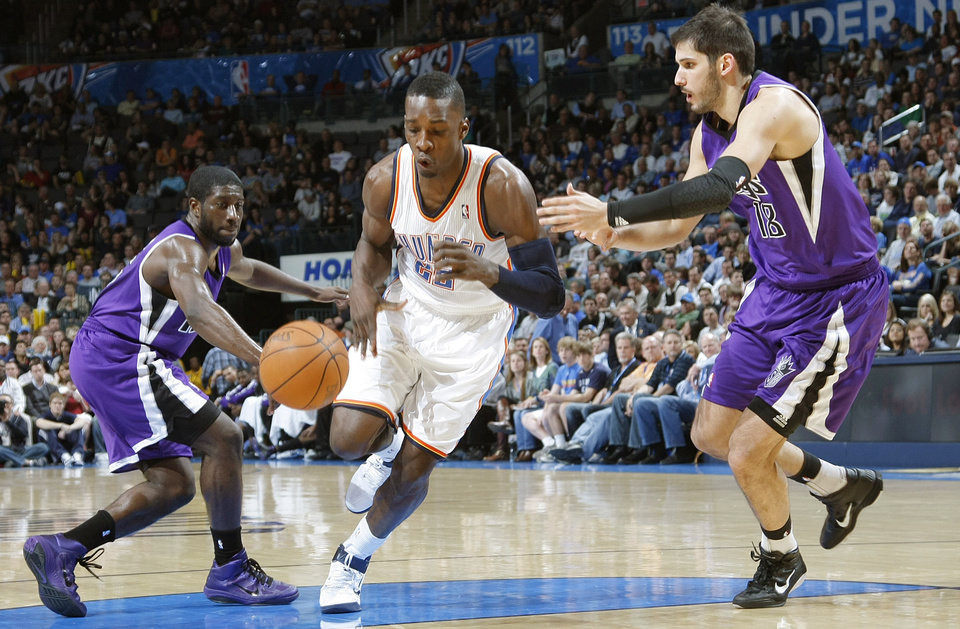 Photo - The Thunder's Jeff Green (22) drives the ball past the Kings' Eugene Jeter (5) and Omri Casspi (18) during the NBA basketball game between the Oklahoma City Thunder and The Sacramento Kings on Tuesday, Feb. 15, 2011, Oklahoma City Okla.  Photo by Chris Landsberger, The Oklahoman