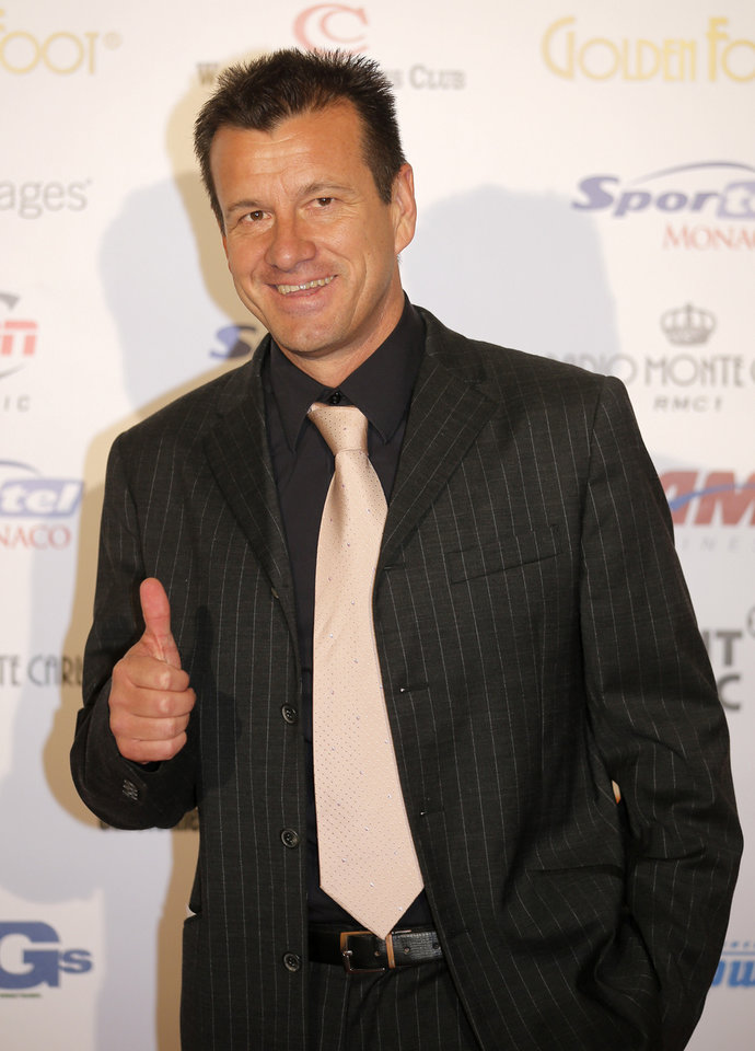 Photo - FILE - In this Oct. 17, 2012, file photo, Brazilian former soccer player Dunga arrives at the ceremony of the