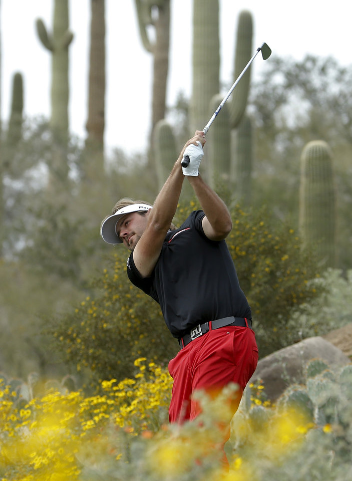 Photo - Victor Dubuisson, of France, watches his tee shot on the 12th hole in his championship match against Jason Day, of  Australia,  during the Match Play Championship golf tournament on Sunday, Feb. 23, 2014, in Marana, Ariz. (AP Photo/Matt York)