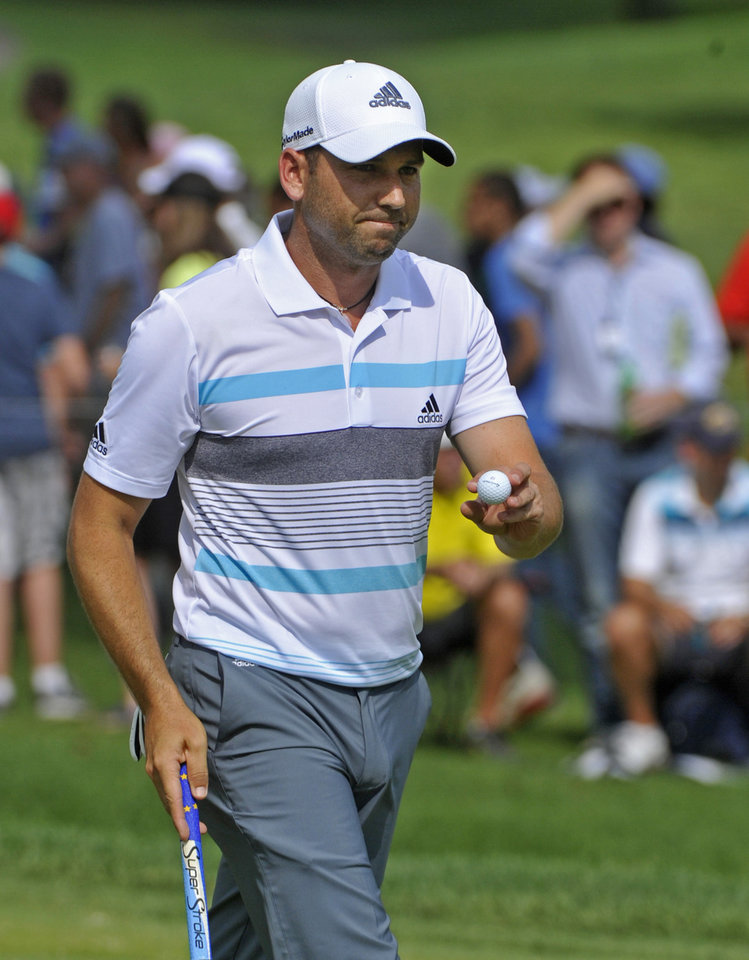 Photo - Sergio Garcia waves after making a par on the eighth hole, during the final round of the Bridgestone Invitational golf tournament, Sunday, Aug. 3, 2014, in Akron, Ohio. (AP Photo/Phil Long)