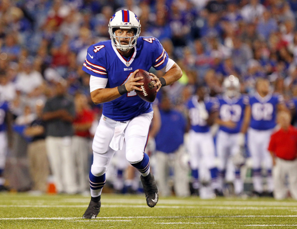 Photo - FILE - In this Aug. 16, 2013, file photo, Buffalo Bills' quarterback Kevin Kolb throws a pass during an NFL preseason football game against the Minnesota Vikings in Orchard Park, N.Y. Without going into detail, general manager Doug Whaley announced Tuesday, March 11, 2014, the team released Kolb after he failed a physical. (AP Photo/Bill Wippert, File)