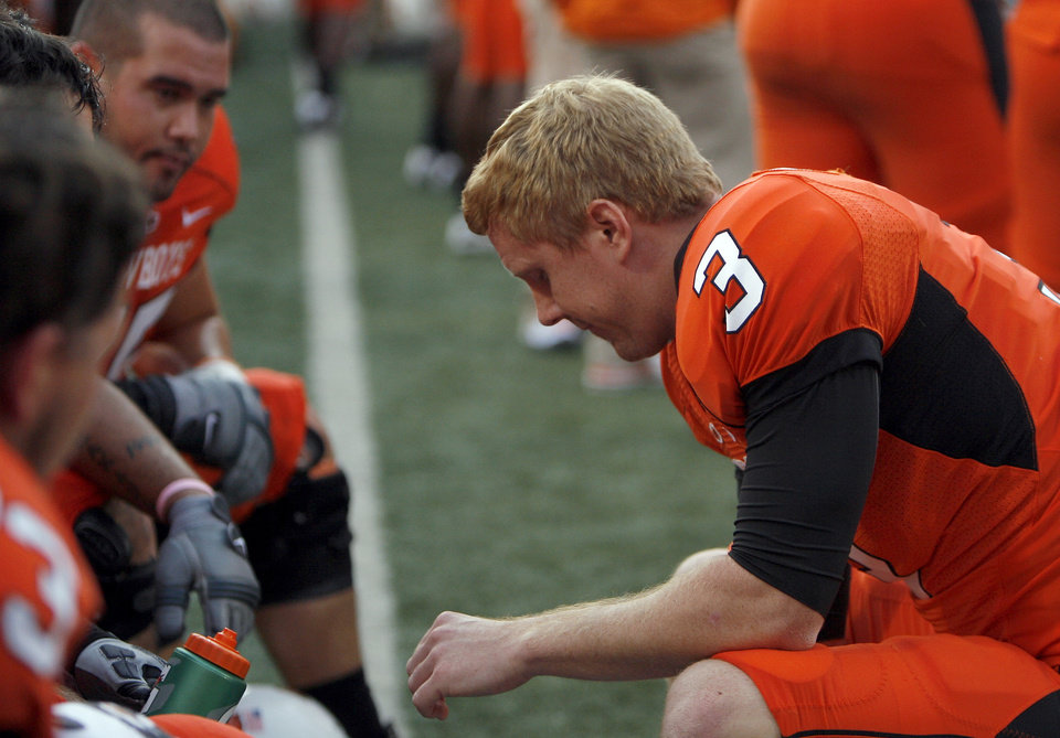 Photo - OSU's Brandon Weeden talks with teammates in the final minute of the college football game between the Oklahoma State Cowboys (OSU) and the Nebraska Huskers (NU) at Boone Pickens Stadium in Stillwater, Okla., Saturday, Oct. 23, 2010. Photo by Sarah Phipps, The Oklahoman