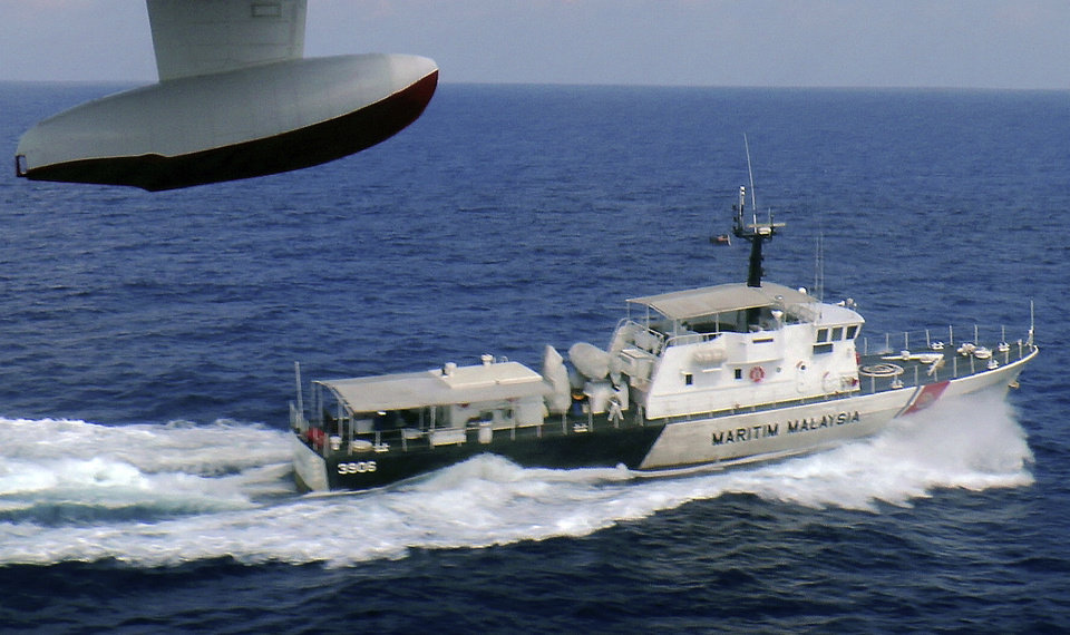 In this photo released by Malaysian Maritime Enforcement Agency, a patrol vessel of Malaysian Maritime Enforcement Agency searches for the missing Malaysia Airlines plane off Tok Bali Beach in Kelantan, Malaysia, Sunday, March 9, 2014. Military radar indicates that the missing Boeing 777 jet may have turned back, Malaysia�s air force chief said Sunday as scores of ships and aircraft from across Asia resumed a hunt for the plane and its 239 passengers. (AP Photo/Malaysian Maritime Enforcement Agency)