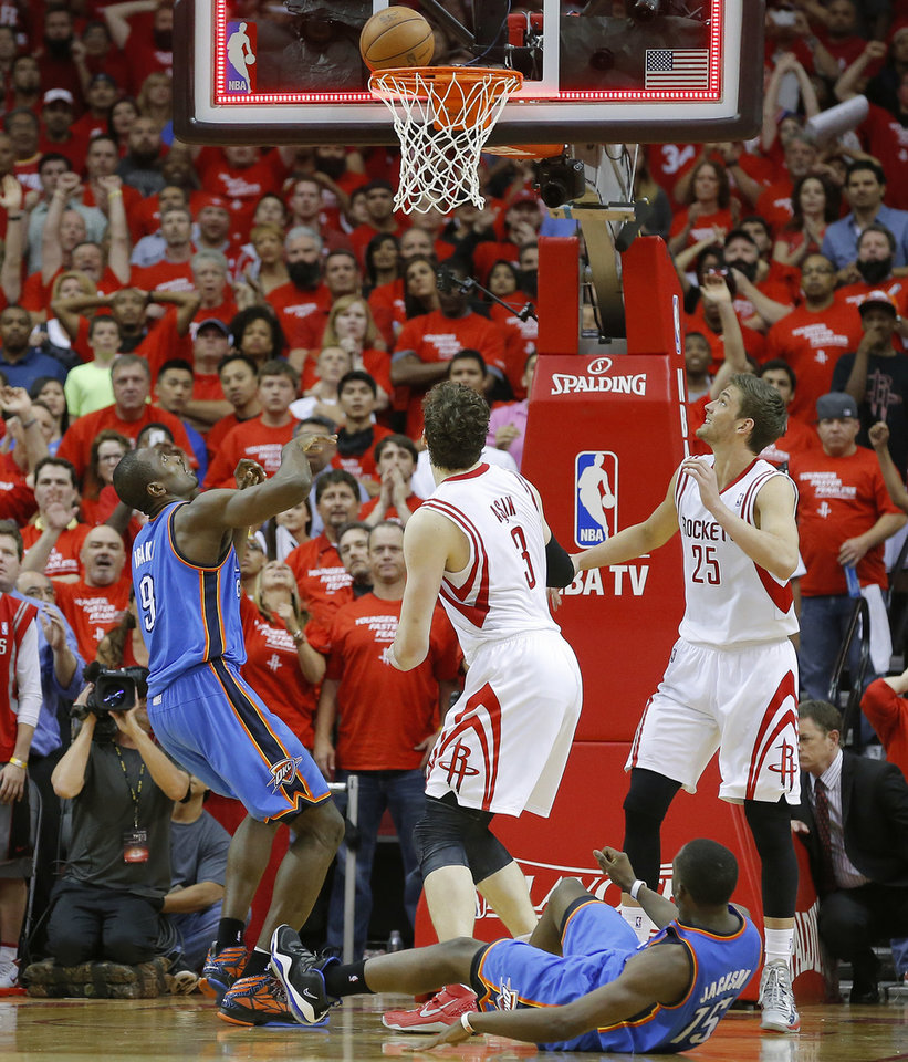 Oklahoma City\'s Serge Ibaka (9) watches his last shot of the game fall off the rim as Houston\'s Omer Asik (3), and Chandler Parsons (25), and Oklahoma City\'s Reggie Jackson (15) watch during Game 4 in the first round of the NBA playoffs between the Oklahoma City Thunder and the Houston Rockets at the Toyota Center in Houston, Texas,Sunday, April 29, 2013. Oklahoma City lost 105-103. Photo by Bryan Terry, The Oklahoman