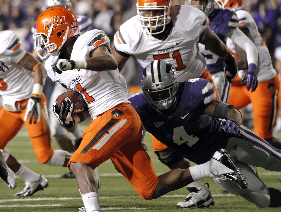 Photo - Oklahoma State's Joseph Randle (1) runs past Kansas State's Arthur Brown (4) during the college football game between the Oklahoma State University Cowboys (OSU) and the Kansas State University Wildcats (KSU) at Bill Snyder Family Football Stadium on Saturday, Nov. 1, 2012, in Manhattan, Kan. Photo by Chris Landsberger, The Oklahoman