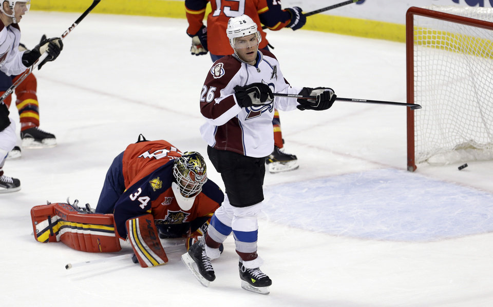 Photo - Colorado Avalanche center Paul Stastny (26) scores a goal against Florida Panthers goalie Tim Thomas (34) during the first period of an NHL hockey game in Sunrise, Fla., Friday, Jan. 24, 2014. (AP Photo/Alan Diaz)