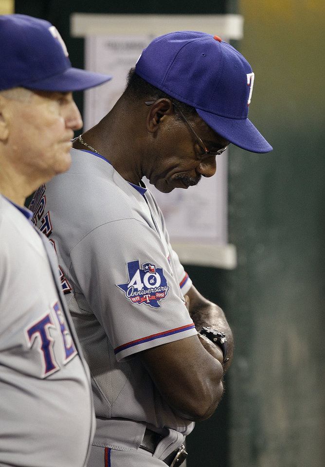 Texas Rangers manager Ron Washington hangs his head in the dugout in the seventh inning of a baseball game against the Oakland Athletics Tuesday, Oct. 2, 2012, in Oakland, Calif. (AP Photo/Ben Margot)