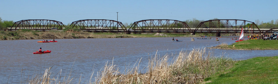 Kayaks ply the waters of the Overholser Lake canal near the old Route 66 bridge on a summer Sunday afternoon. Photo by John Wente