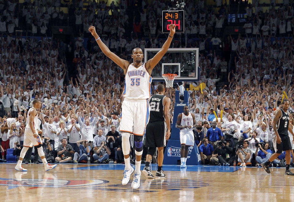 Photo - Oklahoma City's Kevin Durant (35) reacts in the final seconds of the 107-99 win over the Spurs during Game 6 of the Western Conference Finals between the Oklahoma City Thunder and the San Antonio Spurs in the NBA playoffs at the Chesapeake Energy Arena in Oklahoma City, Wednesday, June 6, 2012. Photo by Chris Landsberger, The Oklahoman