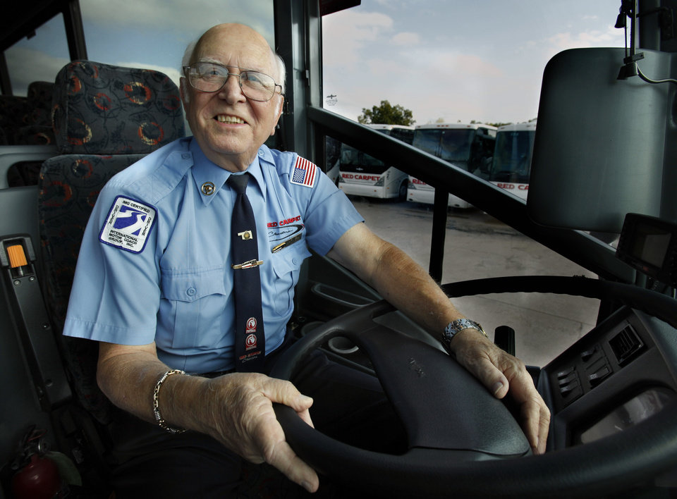 Photo - Bus driver Arvel Lyons, 75, gets ready for a trip on Thursday, Oct. 11, 2012, in Oklahoma City, Okla.  He is the lead bus driver for the University of Oklahoma (OU) football team and will be driving them to Dallas this week for the Red River rivalry.  Photo by Steve Sisney, The Oklahoman