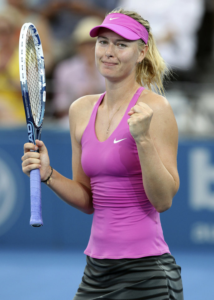 Photo - Maria Sharapova of Russia celebrates after defeating Kaia Kanepi of Estonia during the Brisbane International tennis tournament in Brisbane, Australia, Thursday, Jan. 2, 2014. (AP Photo/Tertius Pickard)