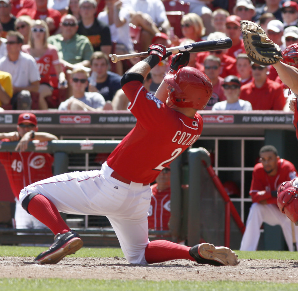 Photo - Cincinnati Reds' Zack Cozart goes down while trying to bunt in the ninth inning of a baseball game against the Boston Red Sox, Wednesday, Aug. 13, 2014, in Cincinnati. The Red Sox won 5-4. (AP Photo/David Kohl)