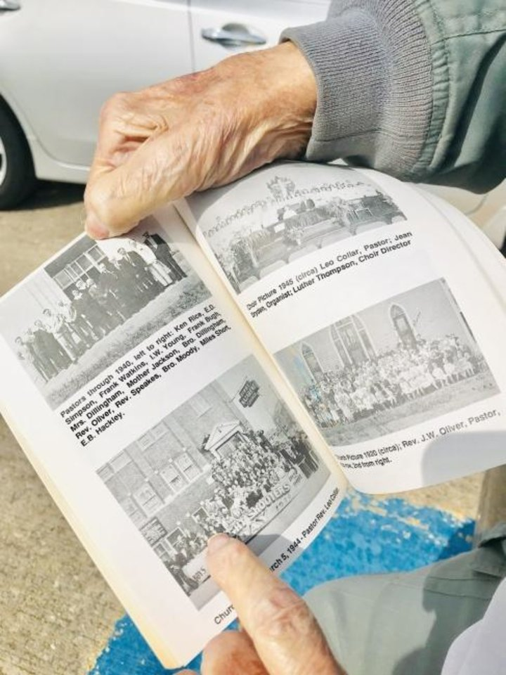 Photo -  Ron Wheeler points to a picture of him and his brother Lawrence as youths in a group photo taken outside Oklahoma City First Church of the Nazarene's former church building at NW 6 and Francis Avenue. [Carla Hinton/The Oklahoman]