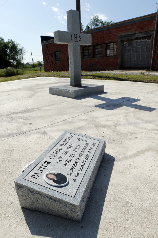 Photo - A memorial now stands on the former site of the Christ Holy Sanctified Church in Anadarko, where pastor Carol Daniels was brutally killed in 2009. The case remains unsolved. Photo by Steve Sisney, The Oklahoman  STEVE SISNEY