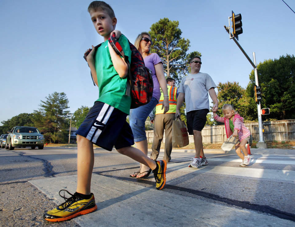 Brandon Berry, third grade, is accompanies to the first day of school by parents Noell and Brian and little sister Addie at Monroe Elementary School on Wednesday, Aug. 22, 2012 in Norman, Okla.  Photo by Steve Sisney, The Oklahoman
