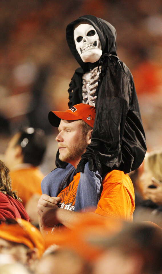 Photo - A young fan dressed in costume during the college football game between the Oklahoma State University Cowboys (OSU) and the University of Texas Longhorns (UT) at Boone Pickens Stadium in Stillwater, Okla., Saturday, Oct. 31, 2009. Photo by Doug Hoke, The Oklahoman