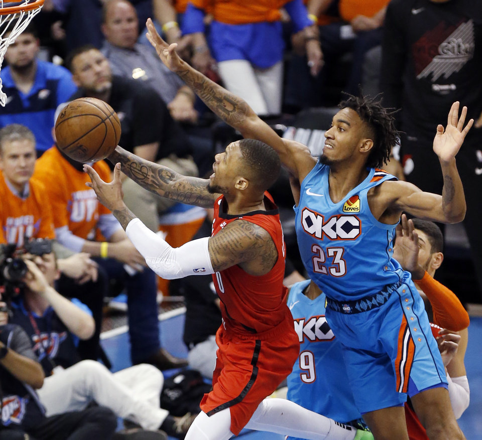 Photo - Portland's Damian Lillard (0) takes the ball to the basket in front of Oklahoma City's Terrance Ferguson (23) in the third quarter during Game 3 in the first round of the NBA playoffs between the Portland Trail Blazers and the Oklahoma City Thunder at Chesapeake Energy Arena in Oklahoma City, Friday, April 19, 2019. Photo by Nate Billings, The Oklahoman