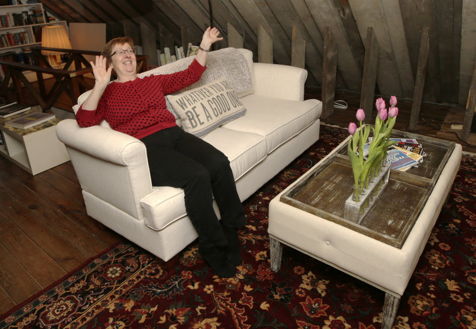 Photo - In this Sunday, Jan. 12, 2014, photo, Marijane Hamren inspects Gwynne's Simplicity Sofa in Tuckahoe, N.Y.  While Simplicity's furniture is sold only over the Internet, some customers want to see and try out the sofas and chairs. Owner Jeff Frank contacts people who have already bought his furniture, and asks them if they'll let a prospective customer stop by to take a look. (AP Photo/Kathy Willens)
