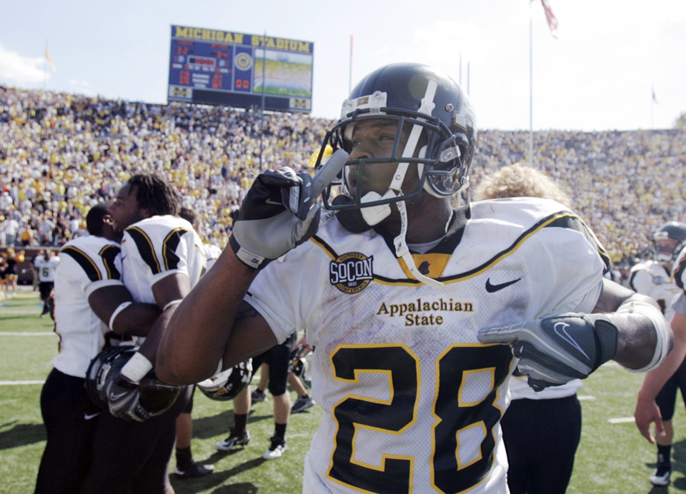 Photo - CELEBRATE, CELEBRATION: Appalachian State running back Kevin Richardson celebrates their 34-32 win over the University of Michigan in a college football game Saturday, Sept. 1, 2007, in Ann Arbor, Mich. (AP Photo/Duane Burleson) ORG XMIT: AAS116