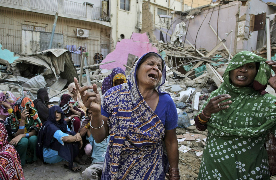 Photo - In this Saturday, Dec. 1, 2012 photo, members of Pakistani Hindu community react next to the rubble of a Hindu temple, which was destroyed on Saturday by a builder, in Karachi, Pakistan. Members of the Pakistan Hindu community in the southern port city of Karachi protested on Sunday over the destruction of a Hindu temple Saturday by a builder who claimed that the land is his. (AP Photo/Fareed Khan)