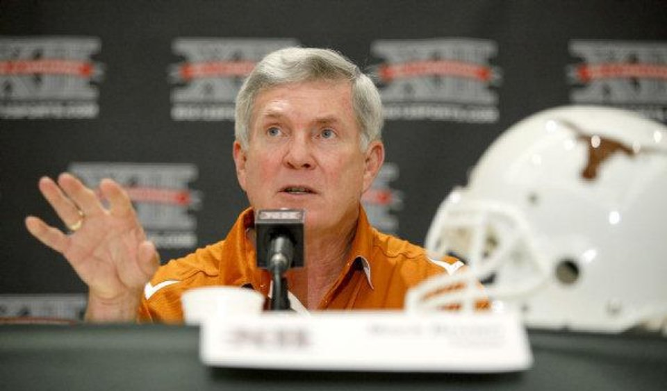 Photo - Texas coach Mack Brown speaks to the media during the Big 12 Conference Football Media Days in Irving, Texas, on  Wednesday. (Photo by Bryan Terry, The Oklahoman)