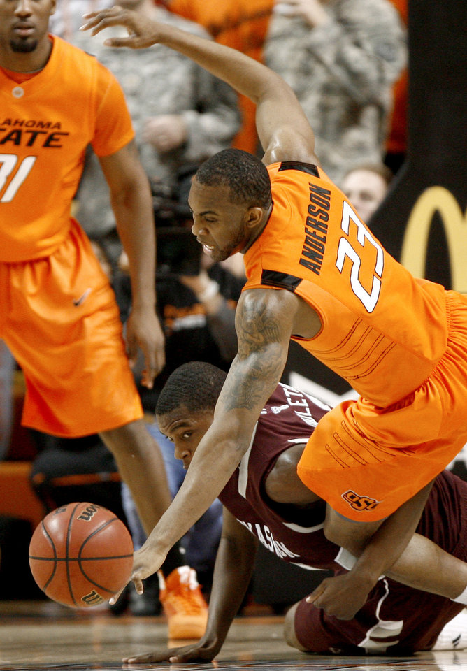 Photo - OSU's James Anderson dives for the ball over Texas A&M's Khris Middleton during an NCAA college basketball game between the Oklahoma State University and Texas A&M at Gallagher-Iba Arena in Stillwater, Okla., Wednesday, January 27, 2010. Photo by Bryan Terry, The Oklahoman