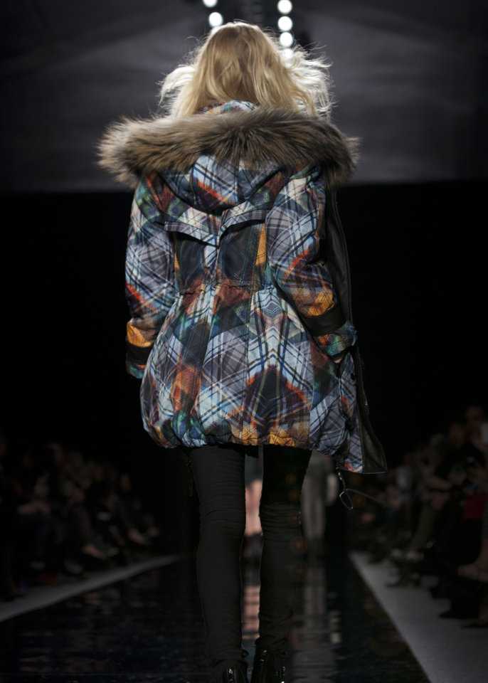 Photo - A model walks the runway during the Nicole Miller Fall 2013 fashion show during Fashion Week, Friday, Feb. 8, 2013, in New York. (AP Photo/Karly Domb Sadof)