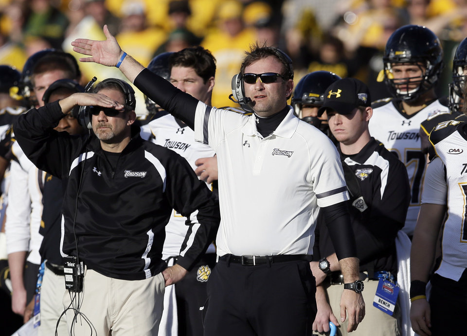 Photo - Towson head coach Rob Ambrose signals to his team in the second half of the FCS championship NCAA college football game against North Dakota State, Saturday, Jan. 4, 2014, in Frisco, Texas. NDSU won 35-7. (AP Photo/Tony Gutierrez)