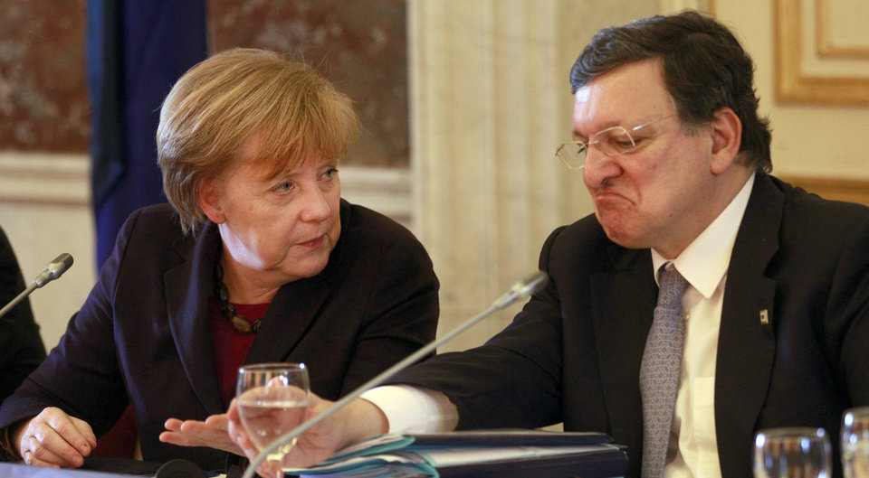 Photo - German Chancellor Angela Merkel, left, speaks with European Commission President Jose Manuel Barroso during a meeting of the EPP ahead of an EU summit in Brussels on Thursday, March 20, 2014. The EU Commission president wants a two-day summit of European Union leaders to center on boosting the fledgling government in Kiev rather than focus exclusively on sanctions against Russia over its annexation of Ukraine's Crimea peninsula. (AP Photo/Yves Logghe)