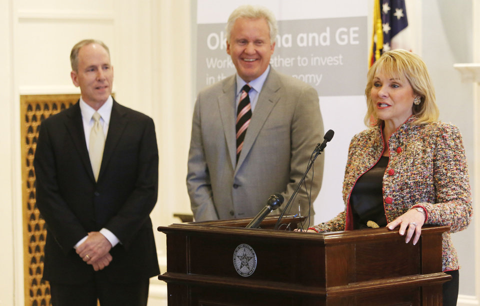 General Electric Senior Vice President and Chief Technology Officer Mark Little, left, Jeff Immelt, GE Chairman and CEO, joined Governor Mary Fallin to announce that GE will build a $110 million global research center in Oklahoma dedicated to driving innovation and technological advancements in the oil and natural gas sector during a press conference at the State Capitol in Oklahoma City , Wednesday April 3, 2013. Photo By Steve Gooch, The Oklahoman ORG XMIT: OKC1303121532440650