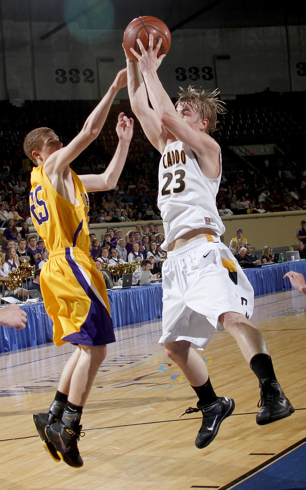 Photo - Cado's Clayton Childree grabs the ball in front of Okarche's Austin Kretchmar during the Class A boys basketball state tournament at the State Fair Arena in Oklahoma City, Friday, March 5, 2010.  Photo by Bryan Terry, The Oklahoman