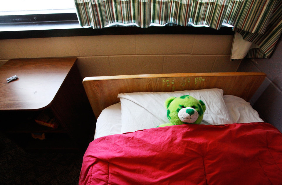 Photo - Left: A teddy bear awaits a child at the DHS shelter in Oklahoma City. PhotoS by Jim Beckel, THE OKLAHOMAN