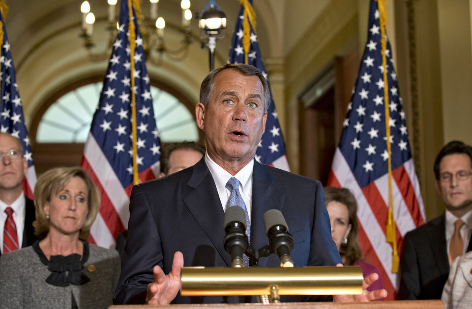 Photo - House Speaker John Boehner of Ohio, accompanied by fellow members of the House GOP leadership, responds to President Barack Obama's remarks to the nation's governors earlier today about how to fend off the impending automatic budget cuts, Monday, Feb. 25, 2013, on Capitol Hill in Washington. (AP Photo/J. Scott Applewhite)