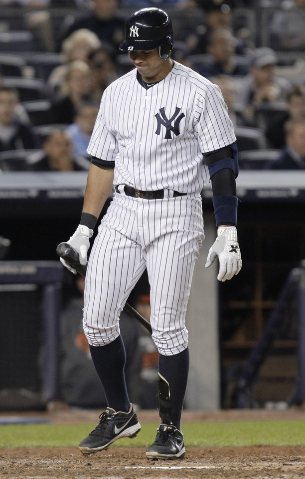Photo -   New York Yankees' Alex Rodriguez looks down after striking out during the sixth inning against the Baltimore Orioles in Game 3 of the American League division baseball series, Wednesday, Oct. 10, 2012, in New York. (AP Photo/Kathy Willens)