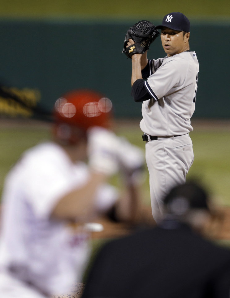 Photo - New York Yankees starting pitcher Hiroki Kuroda prepares to deliver during the fourth inning of a baseball game against the St. Louis Cardinals on Wednesday, May 28, 2014, in St. Louis. (AP Photo/Jeff Roberson)