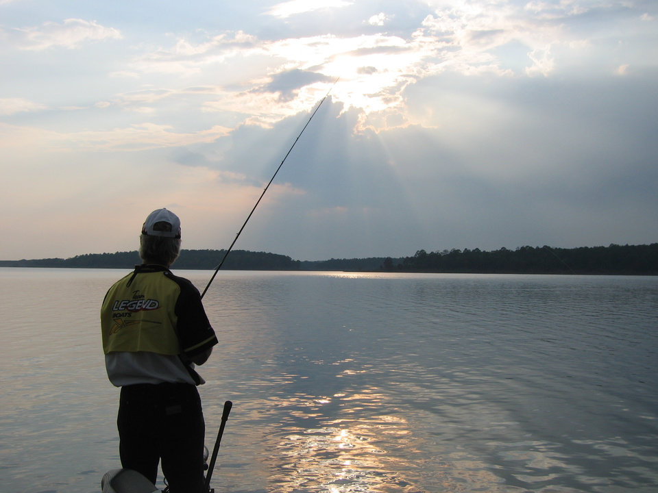Photo -  FISH / FISHING / MCGEE CREEK LAKE: A late-afternoon storm that passed through McGee Creek made for a scenic evening of fishing Wednesday, Aug. 29, 2007, on this 3,800-acre impoundment. Pictured fishing is fishing guide Chuck Justice. - BY ED GODFREY, THE OKLAHOMAN
