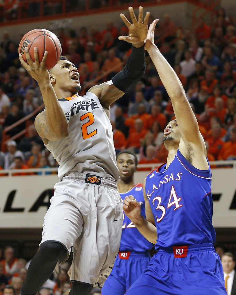 Photo - Oklahoma State's Le'Bryan Nash (2) goes to the basket beside Kansas' Perry Ellis (34) during an NCAA college basketball game between Oklahoma State University (OSU) and the University of Kansas at Gallagher-Iba Arena in Stillwater, Okla., Saturday, March 1, 2014. Oklahoma State won 72-65. Photo by Bryan Terry, The Oklahoman