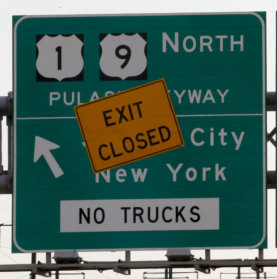Photo - Signs near the blocked off entrance to the northbound side of the Pulaski Skyway alert motorists of the bridge's closure, Monday, April 14, 2014, in Jersey City, N.J. The northbound side of the Skyway was closed on Saturday, April 12, 2014, and will remain closed for two years while $1 billion in repairs are done to the aging bridge. An estimated 40,000 motorists who take the Skyway toward Jersey City and The Holland Tunnel every day are being urged to carpool, take the Turnpike extension or other alternate routes or use public transportation. (AP Photo/Julio Cortez)