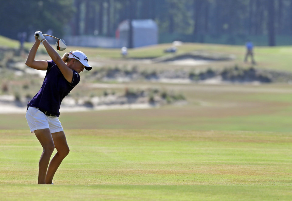 Photo - Stacy Lewis prepares to hit on the 14th hole during the first round of the U.S. Women's Open golf tournament in Pinehurst, N.C., Thursday, June 19, 2014. (AP Photo/Bob Leverone)
