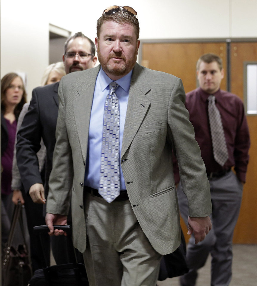 Photo - Defense attorney Daniel King leads his team to court for the third day of a preliminary hearing for Aurora theater shooting suspect James Holmes at the courthouse in Centennial, Colo., on Wednesday, Jan. 9,  2013. (AP Photo/Ed Andrieski)