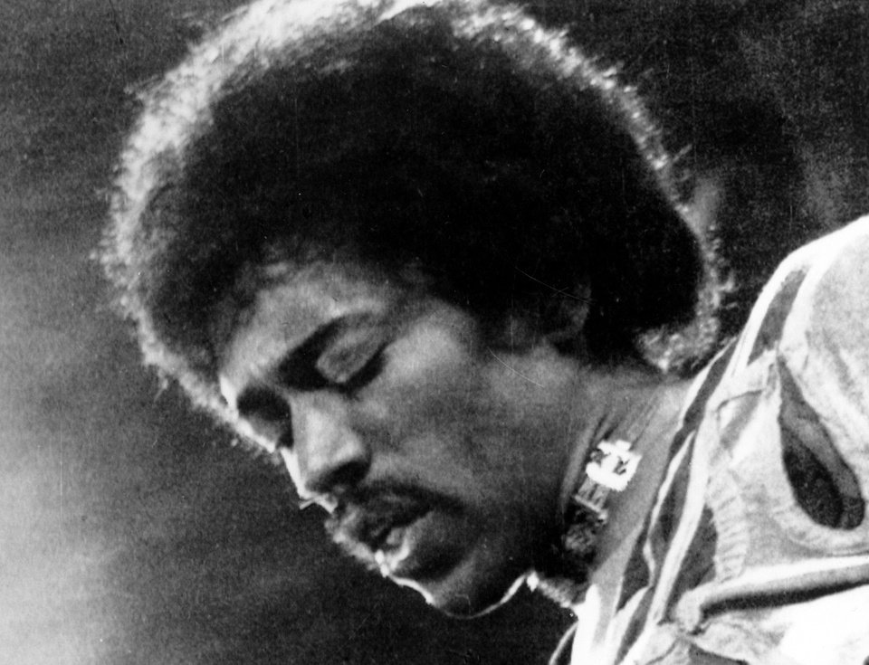 Photo - FILE- In this 1970 file photo, Jimi Hendrix performs on the Isle of Wight in England. Rock 'n' roll will never die, but it's a hazardous occupation. A new study confirms that rock and pop musicians more often die prematurely than the general population, and an early death is twice as likely for solo musicians than for members of bands. (AP Photo/file)