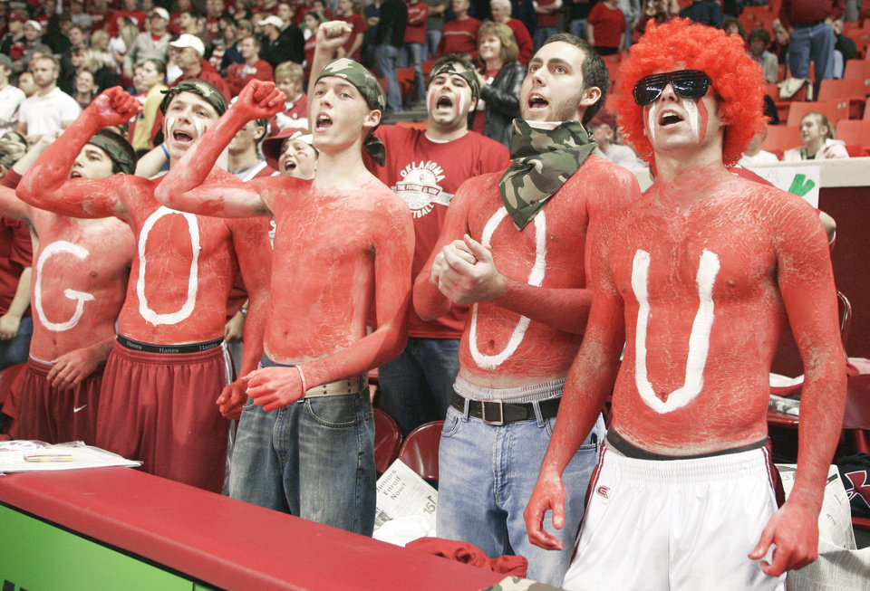 Photo - From left, OU fans Tad Eccles, Elliott Edge, Kyle Hansel, Tim Heaton and Grant Harland, took advantage of a new student-ticket policy for the Sooners' game against American on Friday. Oklahoma State has also instituted a new policy intented to boost attendance. AP photo