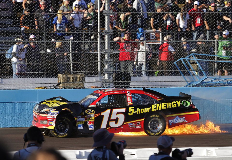 Clint Boyer (15) stops along the front straightaway after being hit by Jeff Gordon during a NASCAR Sprint Cup Series auto race, Sunday, Nov. 11, 2012, at Phoenix International Raceway in Avondale, Ariz. (AP Photo/Matt York)