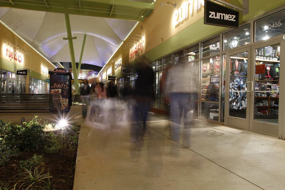Photo - Customers walk through The Outlet Shoppes at Oklahoma City during Black Friday, Thursday, Nov. 24, 2011.  Photo by Garett Fisbeck, For The Oklahoman