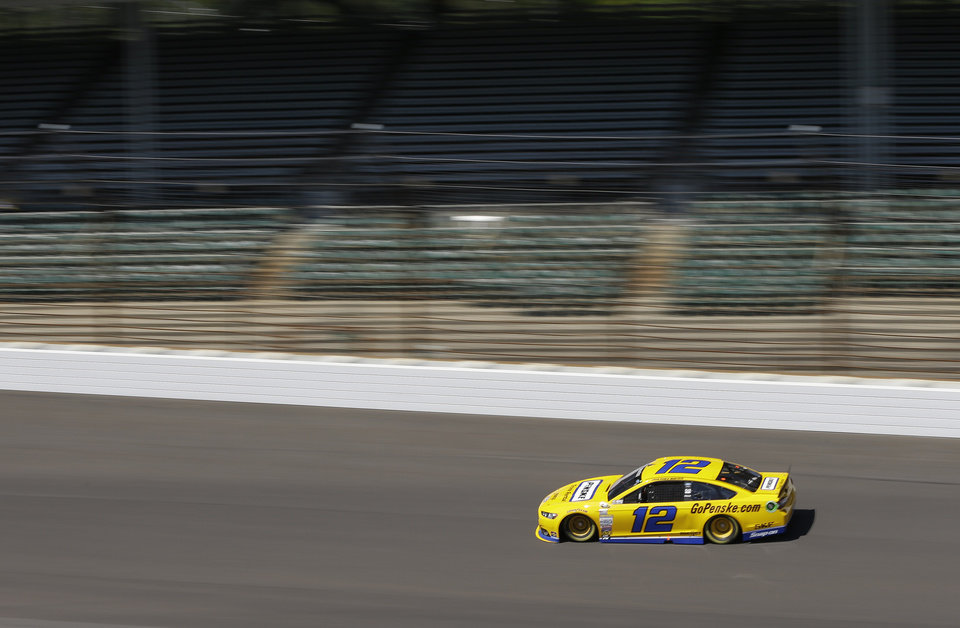 Photo - Driver Juan Pablo Montoya practices for the Brickyard 400 Sprint Cup series auto race at the Indianapolis Motor Speedway in Indianapolis, Friday, July 25, 2014. (AP Photo/Darron Cummings)