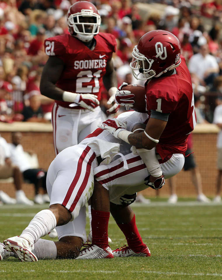 Photo - Ahmad Thomas brings down K. J. Young during the Spring College Football Game of the University of Oklahoma Sooners (OU) at Gaylord Family-Oklahoma Memorial Stadium in Norman, Okla., on Saturday, April 12, 2014.  Photo by Steve Sisney, The Oklahoman