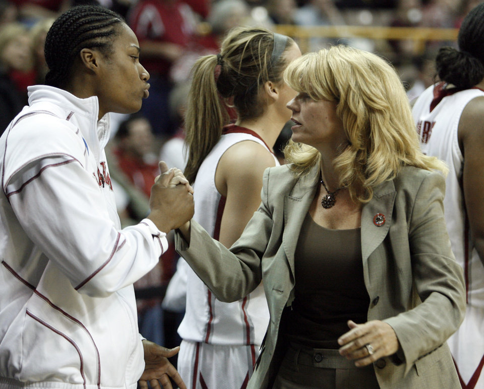 Photo - Amanda Thompson and head coach Sherri Coale shake hands as the University of Oklahoma (OU) defeats Georgia Tech 69-50 in round two of the 2009 NCAA Division I Women's Basketball Tournament at Carver-Hawkeye Arena at the University of Iowa in Iowa City, IA on Tuesday, March 24, 2009. 