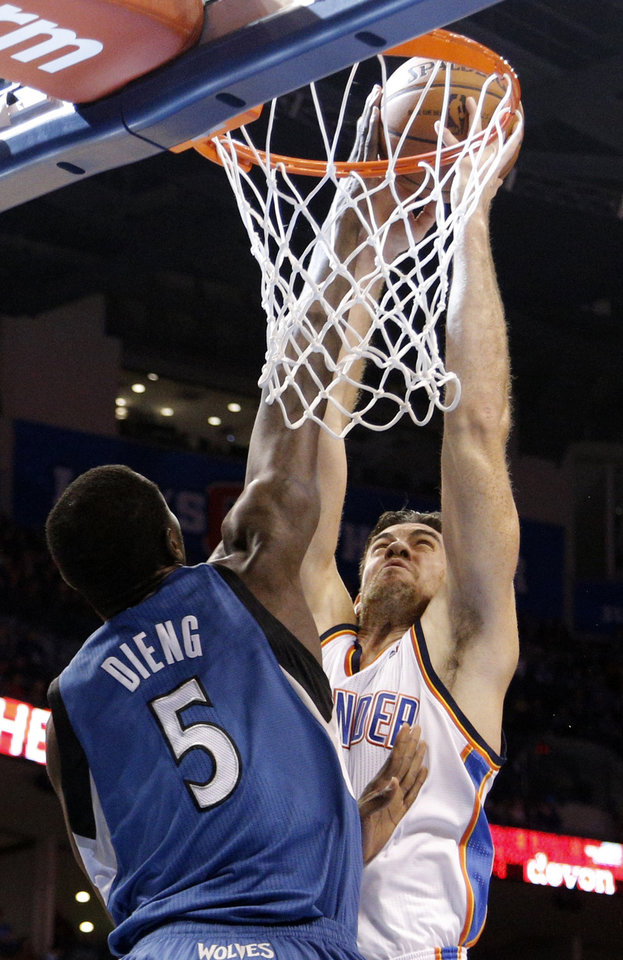 Photo - Oklahoma City's Nick Collison (4)  shoots over Minnesota's Gorgui Dieng (5) during the NBA game between the Oklahoma City Thunder and the Minnesota Timberwolves at the Chesapeake Energy Arena, Sunday, Dec. 1, 2013. Photo by Sarah Phipps, The Oklahoman