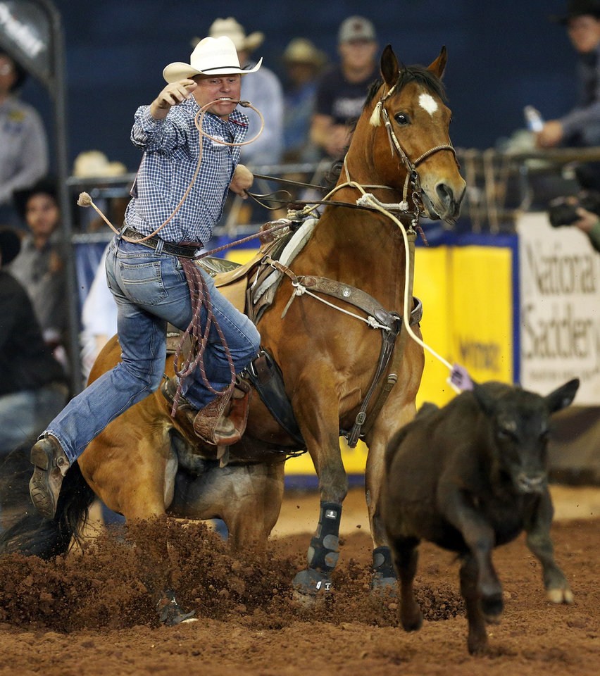 Photo - Justin Maass of Giddings, Texas, competes in tie-down roping during the National Circuit Finals Rodeo at the Lazy E Arena in Guthrie, Okla., Saturday afternoon, April 12, 2014. Photo by Nate Billings, The Oklahoman