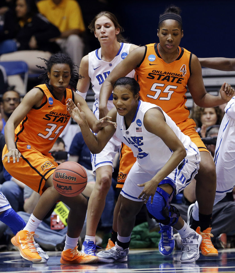 Duke's Richa Jackson, right, and Oklahoma State's Kamri Anderson (35) chase a loose ball during the first half of a second-round game in the women's NCAA college basketball tournament in Durham, N.C., Tuesday, March 26, 2013. Duke's Allison Vernerey, left rear, and Oklahoma State's LaShawn Jones (55) watch. (AP Photo/Gerry Broome)